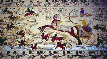 Фараон повергает гискосов, изображённых чёрными людьми в белых одеждах.