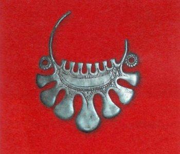 Семилопастные височные кольца вятичей. Железо, X век.